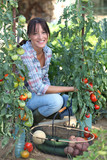 Woman growing vegetables