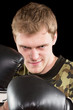 grinning young man in boxing gloves