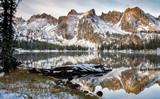 Fototapety Lake reflection of mountains and log winter