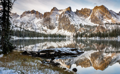 Lake reflection of mountains and log winter