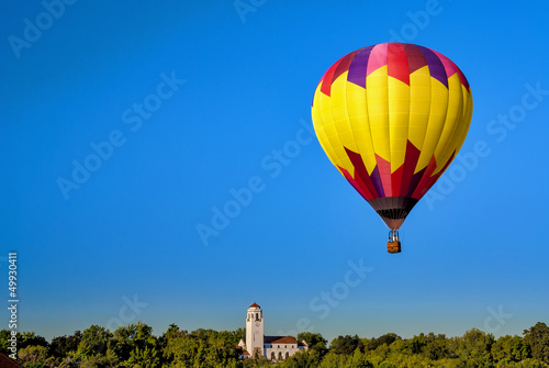 Deep blue sky with a hot air balloon and Boise Idaho train depot