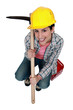 High-angle shot of a tradeswoman holding a pickaxe