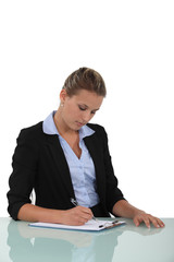 Woman filling in a form