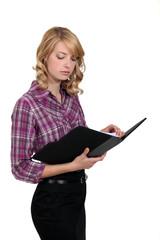 Blond businesswoman checking her schedule