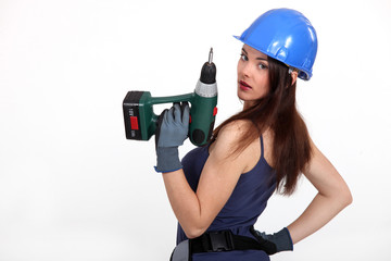 Woman with a power drill