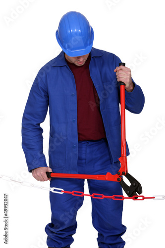 A handyman cutting a chain.