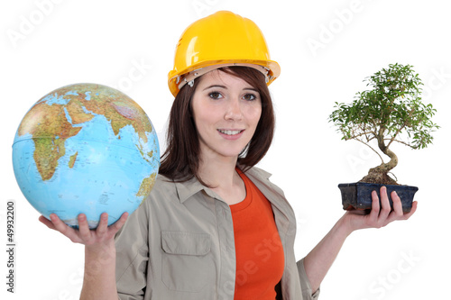 Woman with globe and bonsai