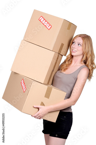 Woman carrying cartons
