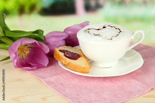 Composition of coffee, toast and tulips on bright background