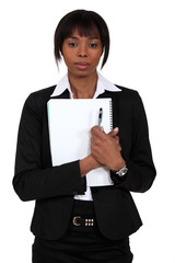 Young businesswoman with a notepad