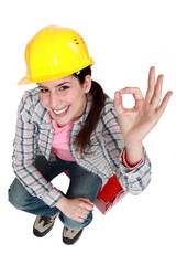 Tradeswoman giving the a-ok sign