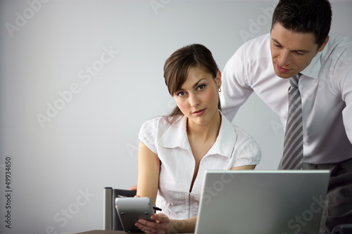 employee at her desk with colleague