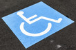 disabled sign on asphalt