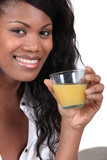 gorgeous black woman drinking orange juice