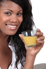 gorgeous black woman drinking orange juice