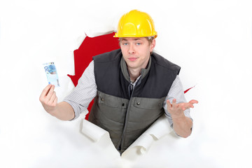 Workers coming out of torn paper hole with ticket in hand