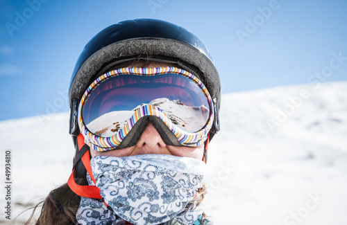 Portrait of a snowboarder in the mountains