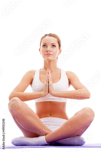 woman practicing yoga in lotus pose