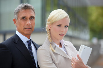Business couple standing outside