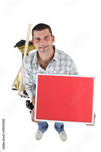 Handyman with a board left blank for your message