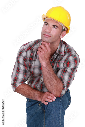 Tradesman with a dreamy look on his face
