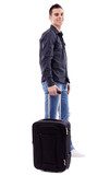 Full length of young man holding his luggage