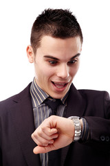 Young man looking at his wristwatch