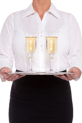 Waitress serving glasses of Champagne