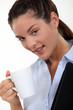 Businesswoman with a hot drink