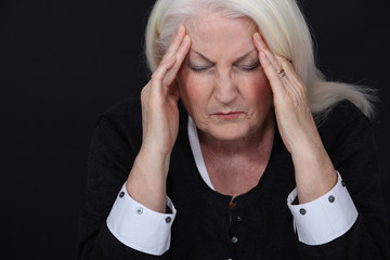 Elderly woman suffering from a headache