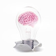 brain of idea. With lamp move up from torn paper
