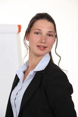 A businesswoman giving a presentation.