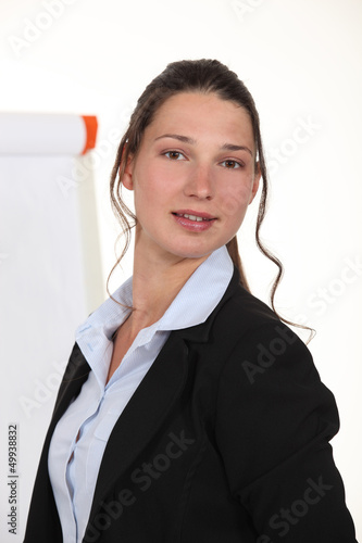 A businesswoman giving a presentation.