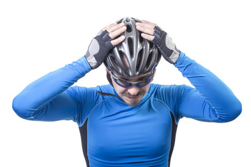 Adult bicyclist put helmet on