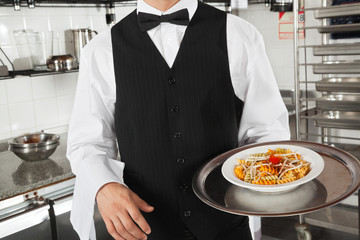 Waiter With Pasta Dish