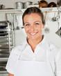 Happy Female Chef In Kitchen