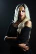 Confident woman portrait over dark background