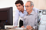 Computer technician helping office worker