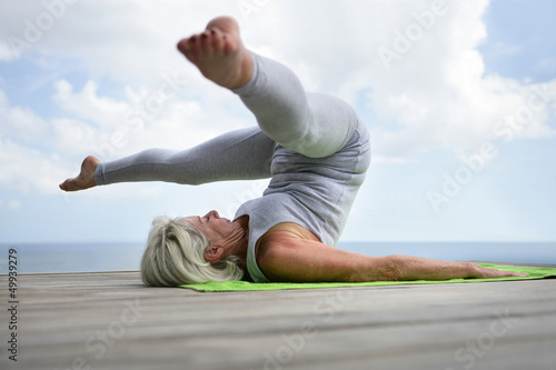 Woman performing a yoga position