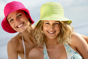 Two female friends having fun at the beach
