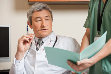 Doctor Reading Patient's File