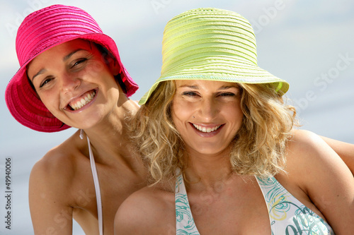 Two female friends having fun at the beach