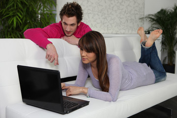 Man and woman in front of a laptop computer