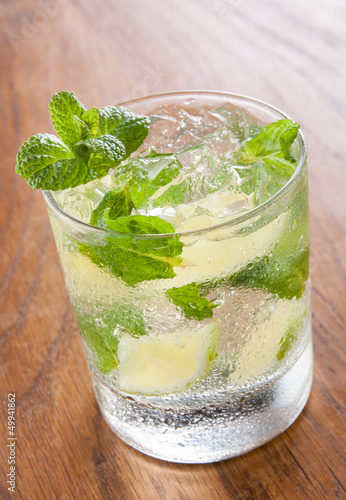 Mojito served in a glass with crushed ice and lime