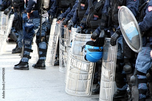 policemen in riot gear with shields and helmets and helmets duri