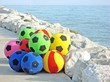 rubber balls for sale on the Italian beach in summer