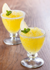 Lemon slushie cups decorated with mint