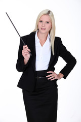 Blond instructor holding stick