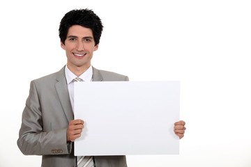 Businessman with a blank board