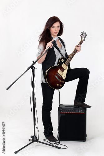 female singer with guitar